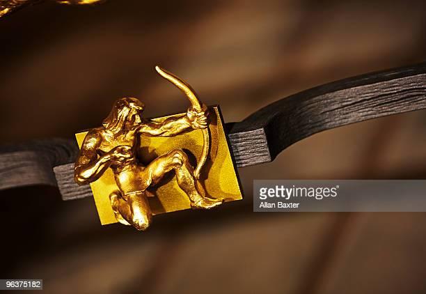 Brass figure of archer