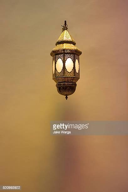 brass lamp hanging, morocco - jake warga stock pictures, royalty-free photos & images