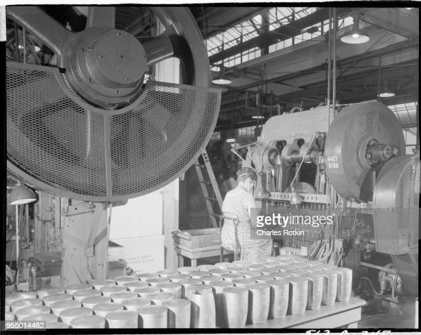 Brass mill Coffee pot bowls being manufactured in a brass mill at the ammunition division of East Alton Works Location East Alton Illinois USA circa...