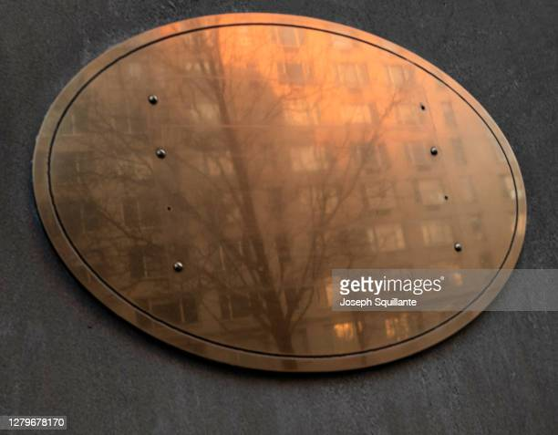 brass oval building plaque - joseph squillante stock pictures, royalty-free photos & images