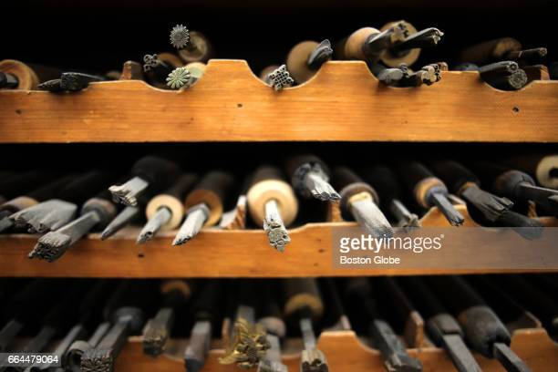 Brass tools used for leather book binding are pictured at Acme Bookbinding in Boston's Charlestown neighborhood on Mar 16 2017 Acme has grown from a...