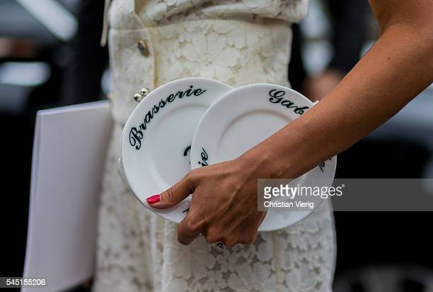 Brasserie Gabrielle Plate Minaudie Chanel bag outside Chanel during Paris Fashion Week Haute Couture F/W 2016/2017 on July 5 2016 in Paris France
