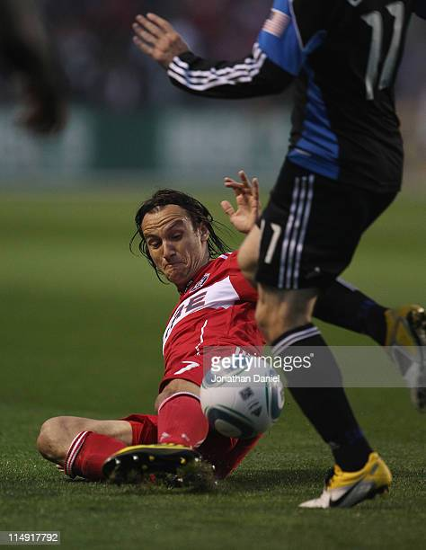 Bratislav Ristic of the Chicago Fire dives to knock the ball away from Bobby Convey of the San Jose Earthquakes during an MLS match at Toyota Park on...
