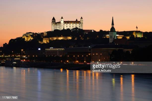 bratislava castle at night - bratislava stock pictures, royalty-free photos & images