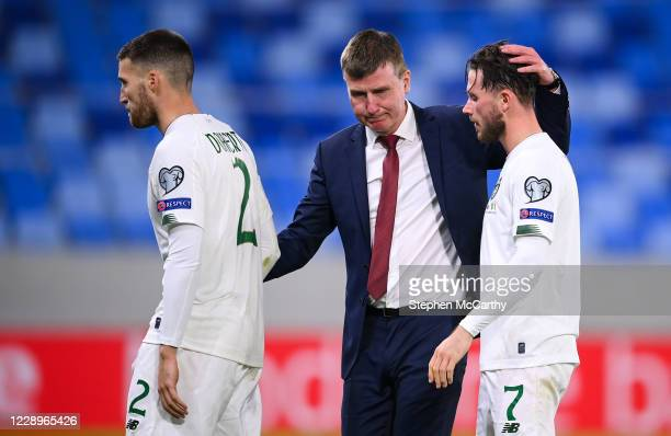 Bratislava , Slovakia - 8 October 2020; Republic of Ireland manager Stephen Kenny consoles Alan Browne, right, and Matt Doherty following defeat in...