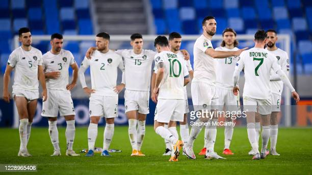 Bratislava , Slovakia - 8 October 2020; Republic of Ireland players, including Shane Duffy, fourth from right, consoles Alan Browne after he missed...