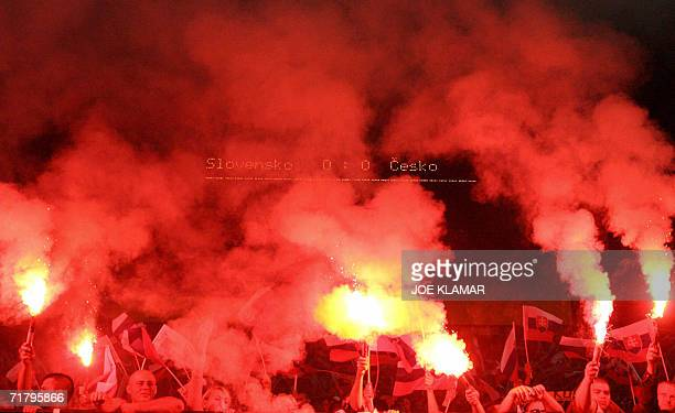 Czech and Slovakia fans light up flares during the UEFA's Euro 2008 group D qualifing match between Slovakia and Czech republic in Bratislava 06...