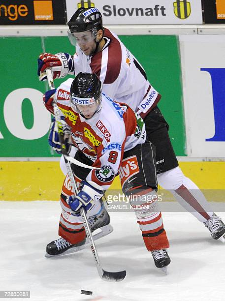 Maris Jass of Latvia vies with Roland Kaspitz of Austria during Loto Cup 2006 match between Latvia and Austria in Bratislava 15 December 2006 AFP...