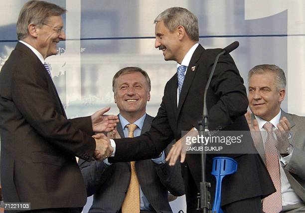 Slovakia's Prime Minister and the leader of the Slovak Democratic and Christian Union Mikulas Dzurinda shakes hands with Austria's Chancellor...