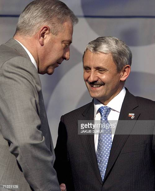 Slovakia's Prime Minister and the leader of the Slovak Democratic and Christian Union Mikulas Dzurinda shakes hands with Croatian Prime Minister Ivo...