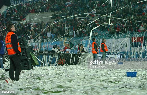 Stewards hopelessly watch flying paper rolls at the Slovan Bratislava stadium during the FIFA World Cup quallification match between Slovakia and...