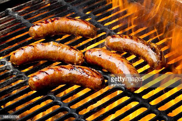 Bratwurst or Hot Dogs on Grill with Flames