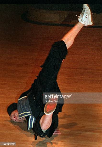 Braun Phillip does his BBoy Best on the boards of the Lowell Hall floor at Harvard University Friday Night as the Boston City Lights school troupe...