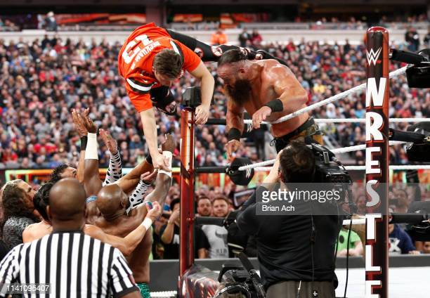 Braun Strowman tosses Colin Jost out of the ring during SNL's Michael Che and Colin Jost at WWE WrestleMania at Met Life Stadium on April 07, 2019 in...