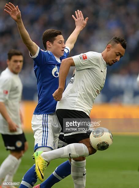 Braunschweig's midfielder Karim Bellarabi and Schalke's midfielder Julian Draxler vie for the ball during the German first division Bundesliga...