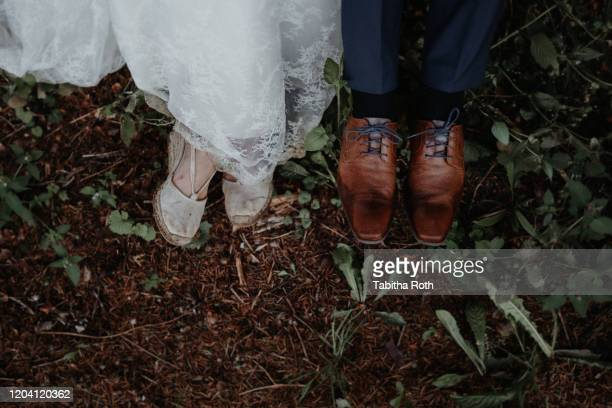braut bräutigam schuhe schmutzig dreckig matschig - dress shoe stock pictures, royalty-free photos & images