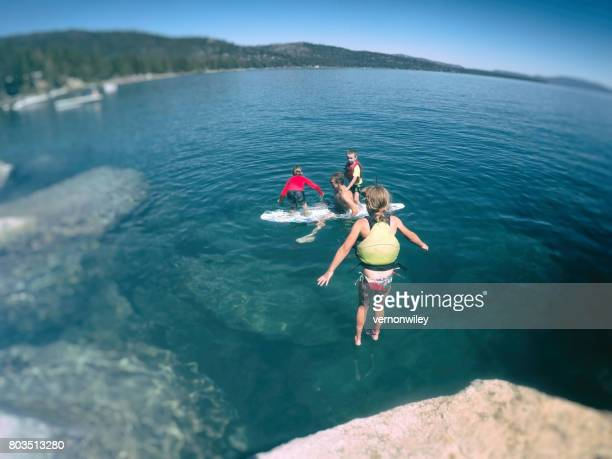 Brave girl jumping to meet family in the water