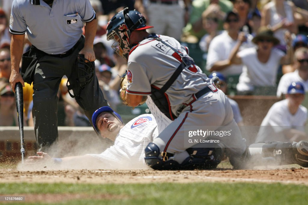 Braves catcher Todd Pratt tags out Michael Barrett at the plate during action between the Atlanta Braves and Chicago Cubs at Wrigley Field in Chicago, Illinois on May 28, 2006. The Braves won 13-12 in 11 innings.