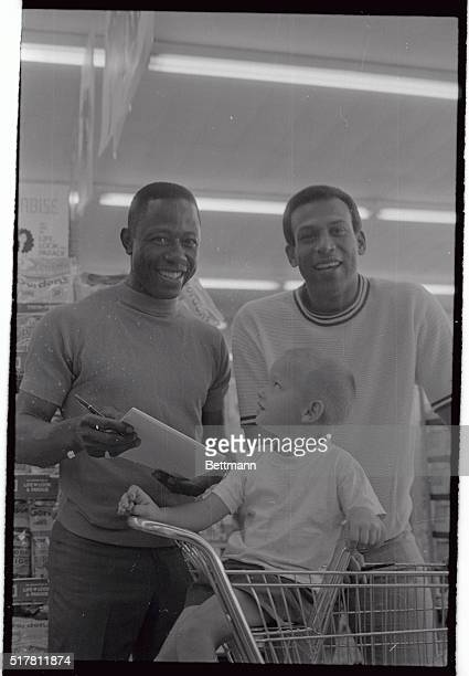Braves Hank Aaron and Orlando Cepeda sign an autograph for young Kenny Simpson of Decatur, Georgia. The Braves had the day off, but the two stars...