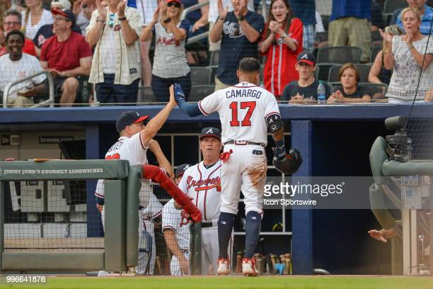 Braves infielder Johan Camargo gets high fives after scoring a run in the second inning during the game between Atlanta and Toronto on July 11th 2018...