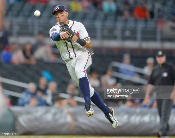 Braves infielder Johan Camargo makes a leaping throw to first base during a game between the Atlanta Braves and San Francisco Giants on June 21 2017...