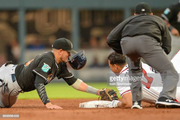 Braves infielder Johan Camargo slides into second base while Marlins shortstop Miguel Rojas applies the tag during the game between Atlanta and Miami...