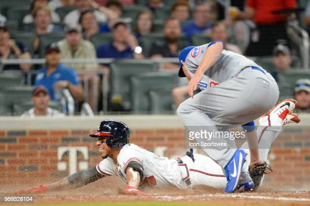 Braves infielder Johan Camargo tries to score on a wild pitch but is tagged out by the Cubs pitcher Mike Montgomery during the game between Atlanta...