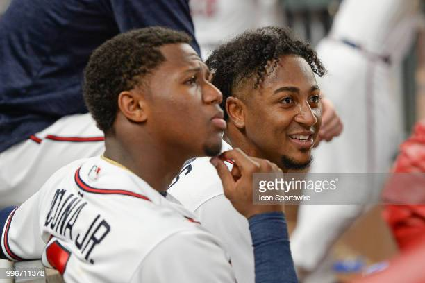Braves infielder Ozzie Albies talks with Ronald Acuna Jr after Albies hit his second home run of the game during the game between Atlanta and Toronto...