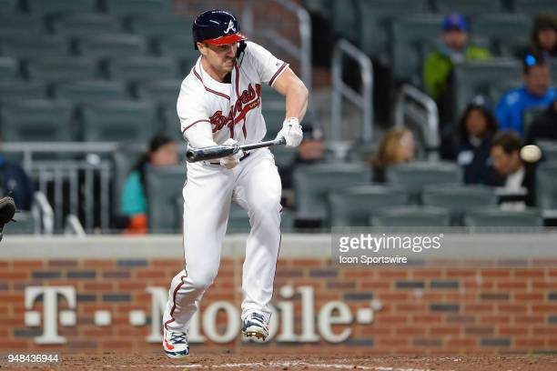 Braves outfielder Lane Adams drops down a bunt during a game between Atlanta and Philadelphia on April 16 2018 at SunTrust Park in Atlanta GA The...