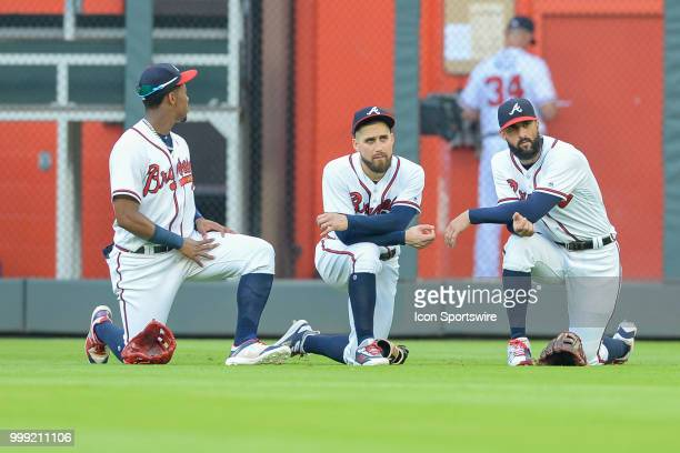 Braves outfielders Ronald Acuna Jr Ender Inciarte and Nick Markakis take a knee during a break in the action during the game between Atlanta and...