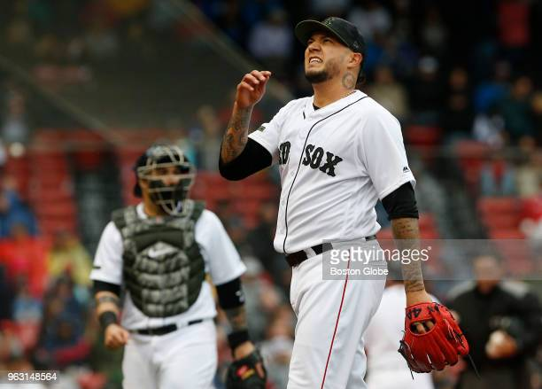 Braves' pitcher Hector Velazquez walks back to the dugout during the ninth inning of a game between the Boston Red Sox and Atlanta Braves at Fenway...