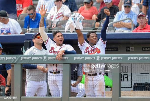 Braves players Johan Camargo and Ronald Acuna Jr wave to fans in between innings during the game between Atlanta and Boston on September 5th 2018 at...