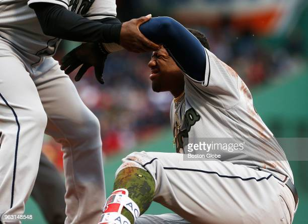 Braves Ronald Acuna Jr is helped up after taking a nasty fall at first base during the seventh inning of a game between the Boston Red Sox and...