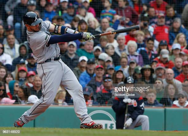 Braves Tyler Flowers follows through on the swing of his three run home run during the second inning of a game between the Boston Red Sox and Atlanta...