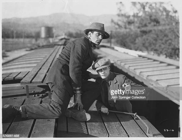 Bravo and Barbara Brown dressed as a man stow away on a train in Miss Nobody