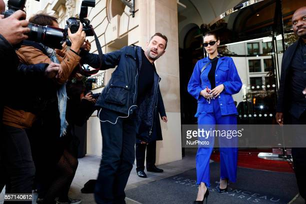 A brawl between photographers as Bella Hadid leaves her hotel Royal Monceau in Paris France Hadid's bodyguard tries to keep the photographers in...