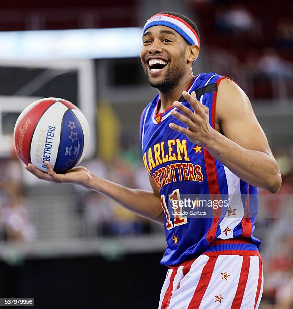 Brawley 'Cheese' Chisholm of Harlem Globetrotters keeps the ball during the exhibition game between Harlem Globetrotters and World AllStars at Laszlo...