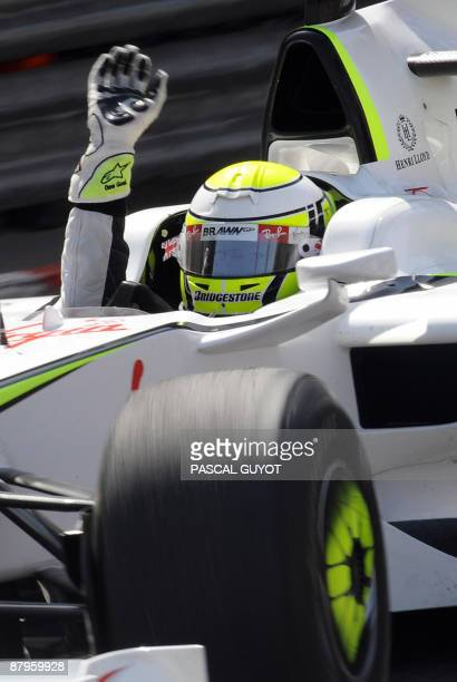 Brawn GP's British driver Jenson Button celebrates as he drives at the Monaco racetrack on May 24 2009 in Monte Carlo after the Monaco Formula One...