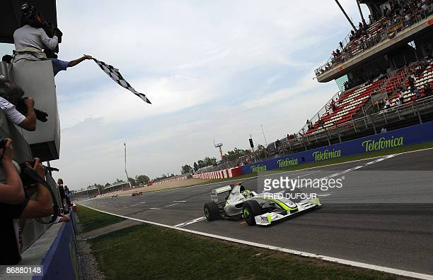 Brawn GP's British driver Jenson Button crosses the finish line of the Circuit de Catalunya, on May 10, 2009 in Montmelo, near Barcelona, at the end...