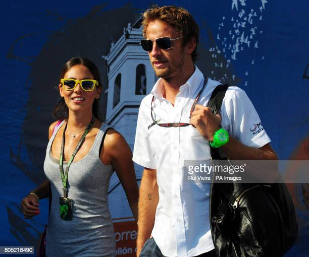 Brawn GP's Jenson Button and girlfriend Jessica Michibata arrive at the circuit for the European Formula One Grand Prix at the Circuit Valencia Spain