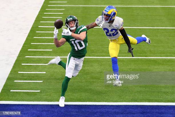 Braxton Berrios of the New York Jets unable to make a catch ahead of defender Troy Hill of the Los Angeles Rams during the second quarter of a game...