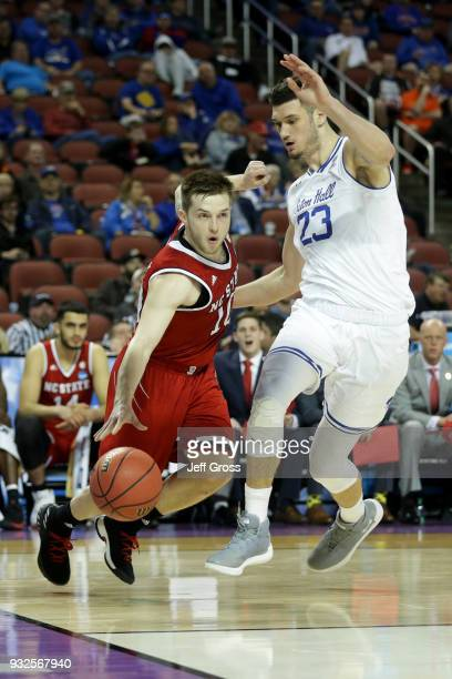 Braxton Beverly of the North Carolina State Wolfpack dribbles the ball while being guarded by Sandro Mamukelashvili of the Seton Hall Pirates in the...