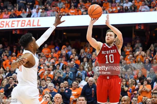 Braxton Beverly of the North Carolina State Wolfpack shoots the ball as Oshae Brissett of the Syracuse Orange defends during the second half at the...