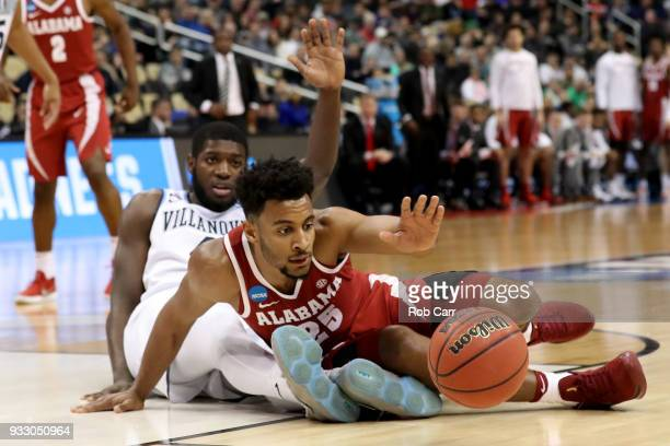 Braxton Key of the Alabama Crimson Tide fights for the ball against Eric Paschall of the Villanova Wildcats during the first half in the second round...