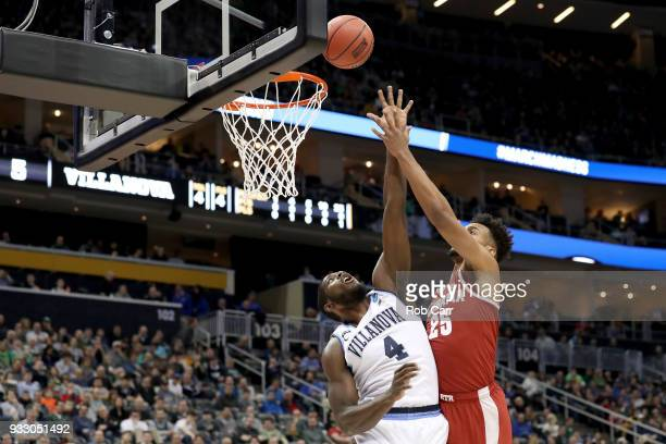 Braxton Key of the Alabama Crimson Tide shoots the ball over Eric Paschall of the Villanova Wildcats during the first half in the second round of the...