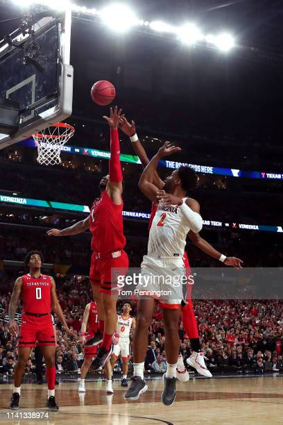 Braxton Key of the Virginia Cavaliers attempts a shot against Brandone Francis of the Texas Tech Red Raiders in the first half during the 2019 NCAA...