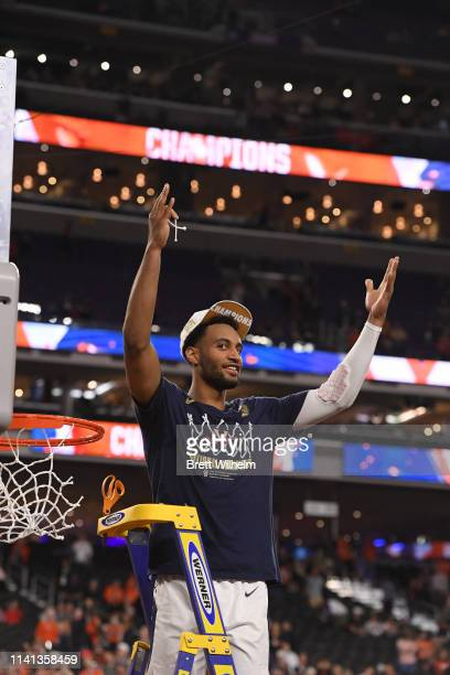 Braxton Key of the Virginia Cavaliers cuts his piece of the net after winning the 2019 NCAA men's Final Four National Championship game at US Bank...