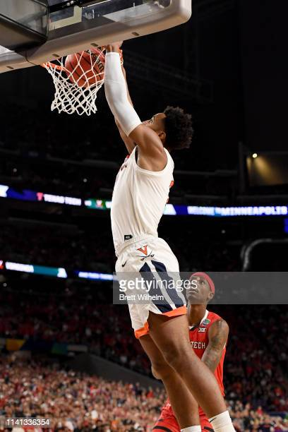 Braxton Key of the Virginia Cavaliers dunks on Tariq Owens of the Texas Tech Red Raiders during the first half in the 2019 NCAA men's Final Four...