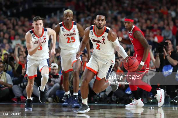 Braxton Key of the Virginia Cavaliers handles the ball on offense against the Texas Tech Red Raiders in the first half during the 2019 NCAA men's...