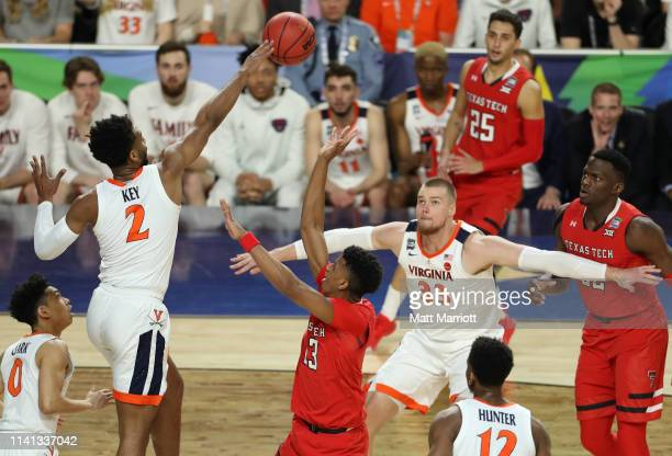 Braxton Key of the Virginia Cavaliers reaches for a loose ball during the first half in the 2019 NCAA men's Final Four National Championship game at...